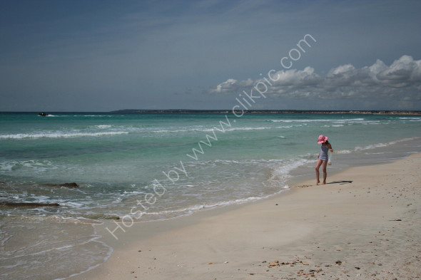 Searching for shells on Es Trenc beach on the South coast
