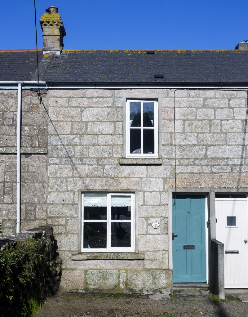 Cottage front with dedicated car parking in front of the door