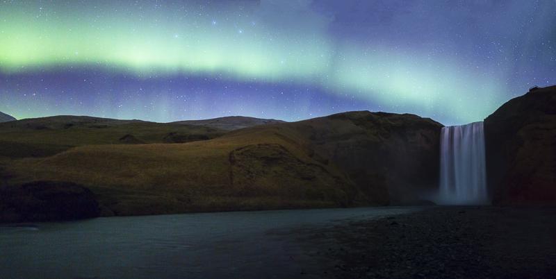 Aurora arc over Skogafoss