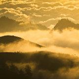 Sunset clouds around the rim of Rinjani