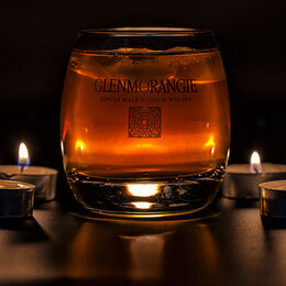 GLENMORANGIE: Use of artificial light to good effect. Well handled and exposed. Detail clear including ice in glass. Tealights also well handled.