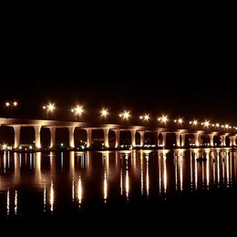 ILLUMINATED BRIDGE: Light is what picture is about. Follow the lights left to right. Light and dark with nice star effect from the lights.