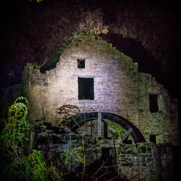 LIGHT ON THE MILL: Well lit derelict building at night. Light not too harsh. Well depicted and can see detail and shadows.