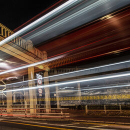 LIGHT TRAILS: Completely different use of light. Grabs the attention and holds it even if sign catches eye. Lovely colour, well exposed and an ordinary scene lifted in interest.