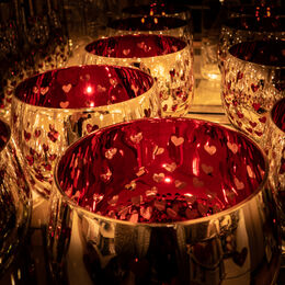 LOVING CUPS: A riot of gold and reds not forgetting the hearts. Well seen composed and taken. Eyes held to three central cups. However, can see the photographer in the reflections.