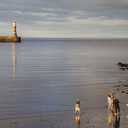 ROKER: A good minimal image with a good use of light. A well balanced image with lighthouse to the left with reflection and figures to bottom right again with reflections.