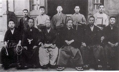 Young Shimizu Takaji Sensei (L) holding a Kusarigama