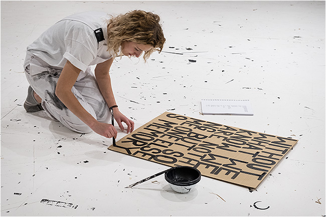 Artist painting a selected slogan