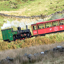 Snowdon Mountain Railway steaming past Dinorwic