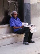 "Cuban ""Granma"" Newspaper Seller"
