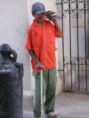 """Cuban selling """"Granma"""" Newspaper, Havana"""