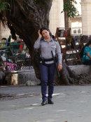 Cuban Police Woman with Gun, Plaza Armas, Havana