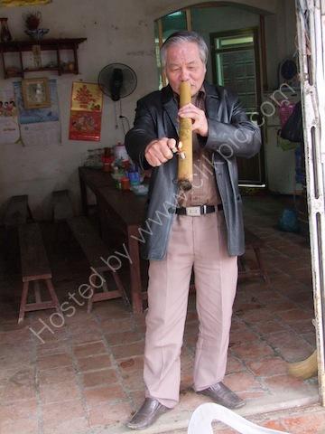 Vietnamese Man smoking Traditional Chinese Pipe