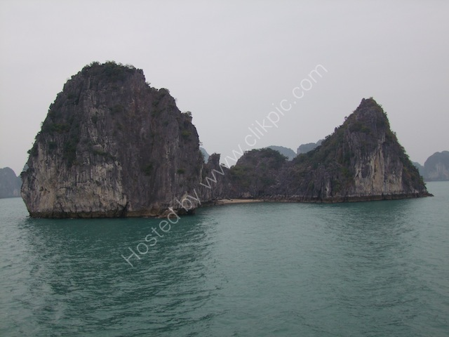 Beach between Limestone Rock Formations, Halong Bay