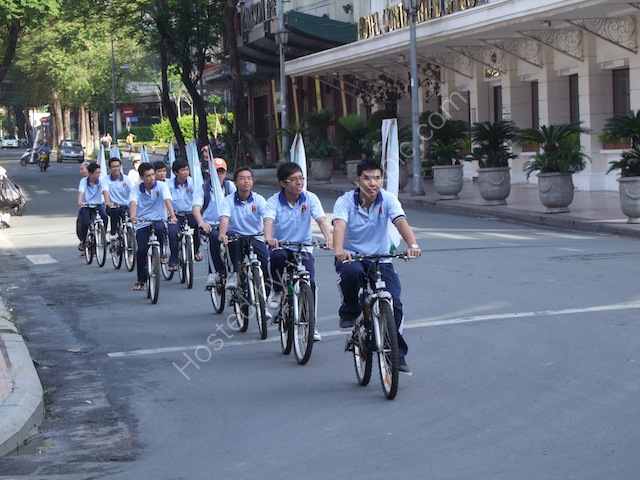Cyclists with Banners, Ho Chi Minh City