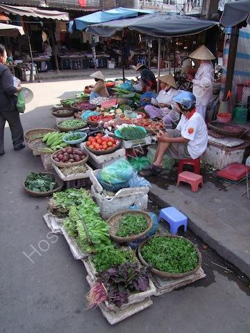 Greengrocer outside Hoi An Market