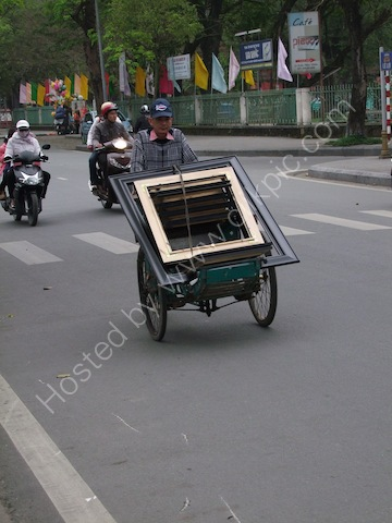 Carrying Load of Picture Frames on Cyclo, Hue