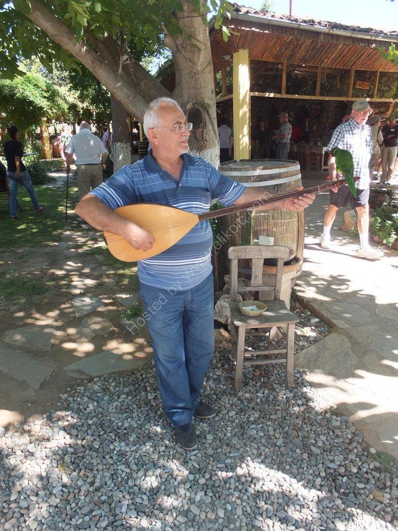 Musician with Parrot, Anatolia Restaurant, Aphrodisias