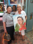 Artist Martalena with painting we bought, Havana