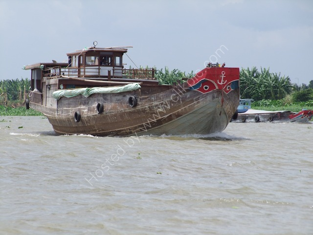 Rice Boat on the Mekong Delta