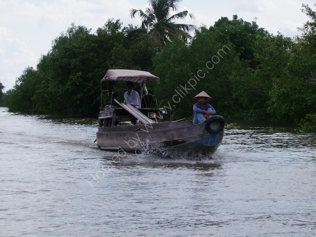 Small Boat Underway on the Mekong Delta