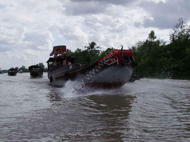 Line of Rice Boats Underway on the Mekong Delta