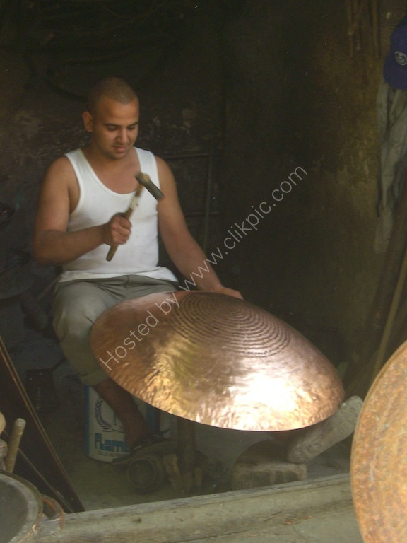 Moroccan Man Shaping Copper Cooking Pot