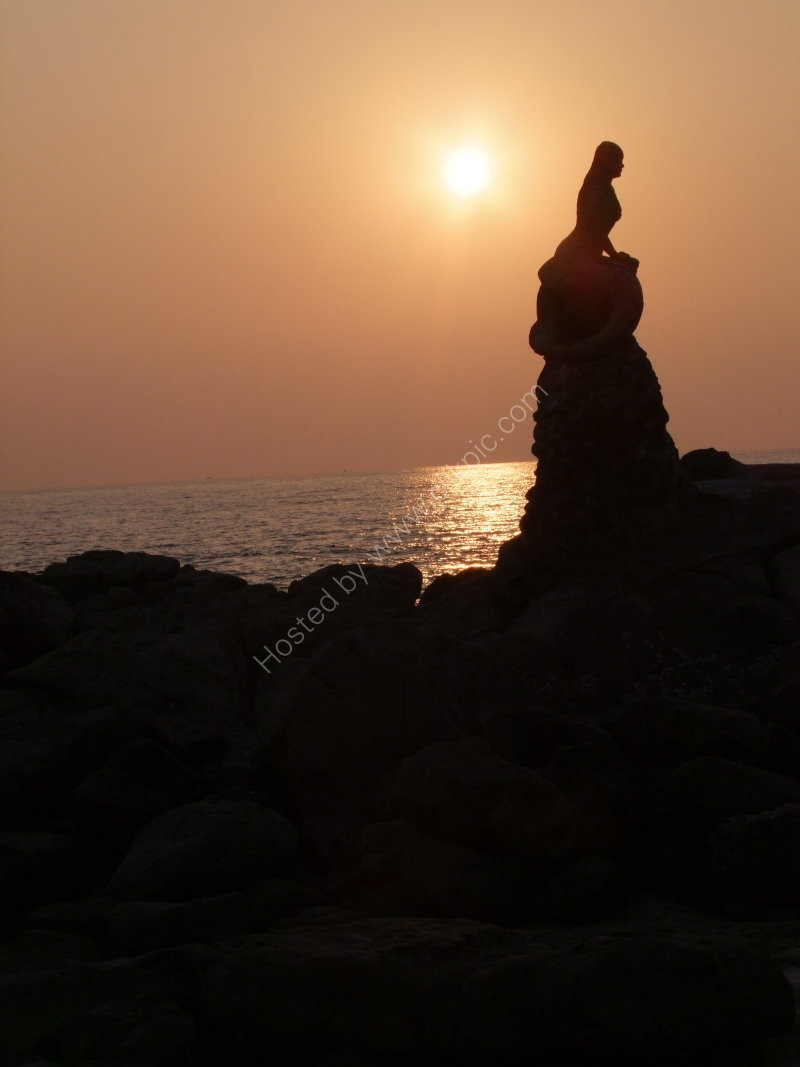 Silhouette of Mermaid on the Rock
