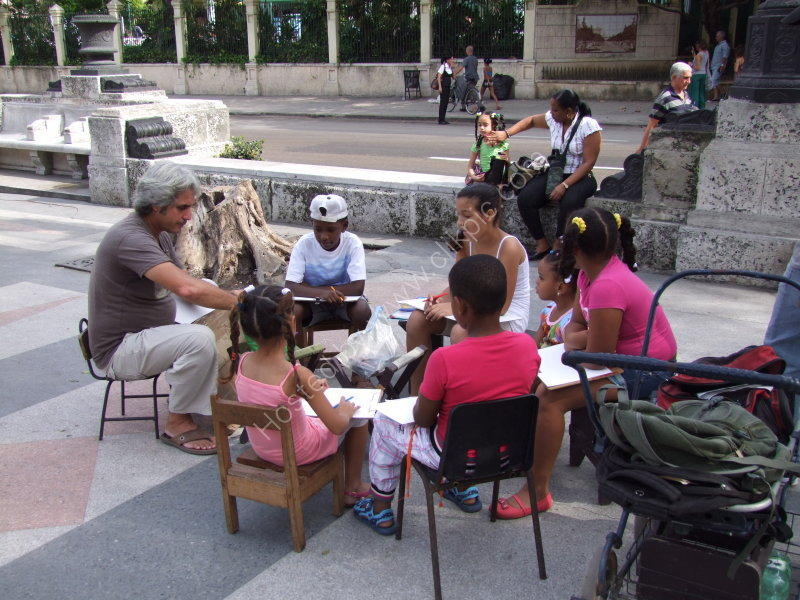 Cuban artist teaching Cuban children to draw, Prado, Havana
