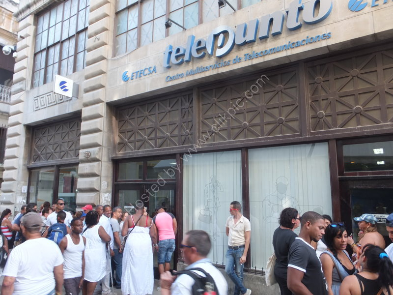 Cubans queuing to telephone at telephone exchange, Obispo Street, Havana