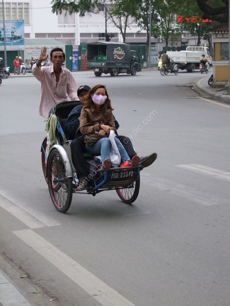 Vietnamese Man Driving a Cyclo