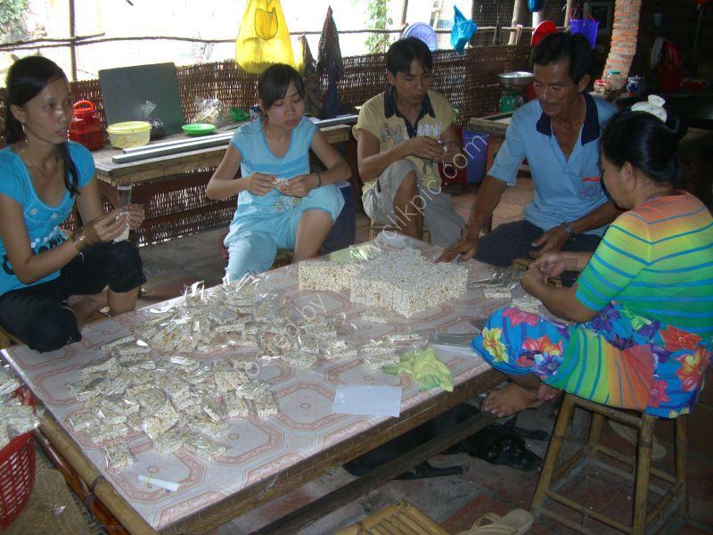 Vietnamese People Packing Rice Crispy Sweets