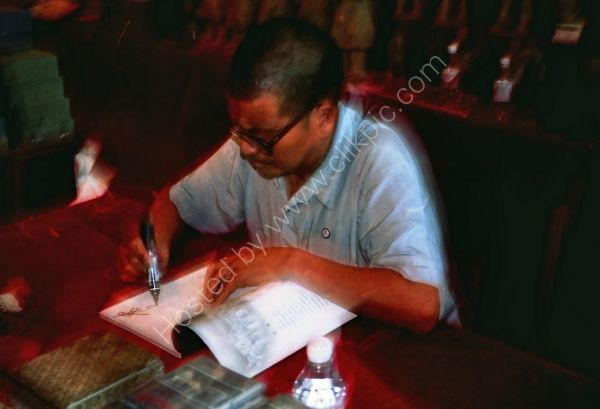 One of the Farmers who found the Terracota Warriors signing a book, Xian