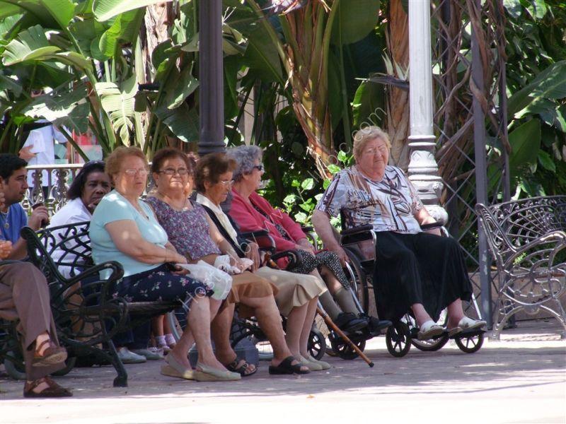 Spanish women watching the world go by! Main plazza, Fuegirola, Spain