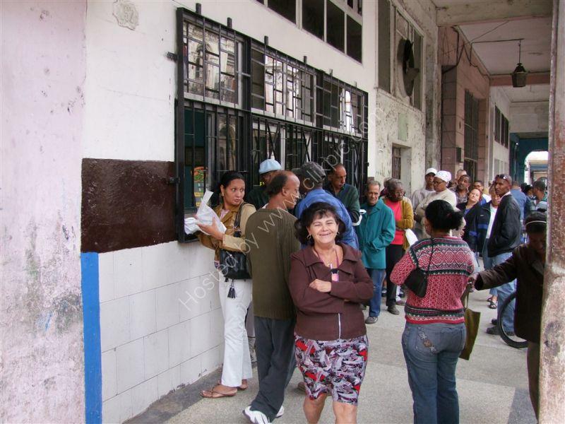 Cubans Queing at a shop, Avenue Simon Bolivar (Reina), Havana