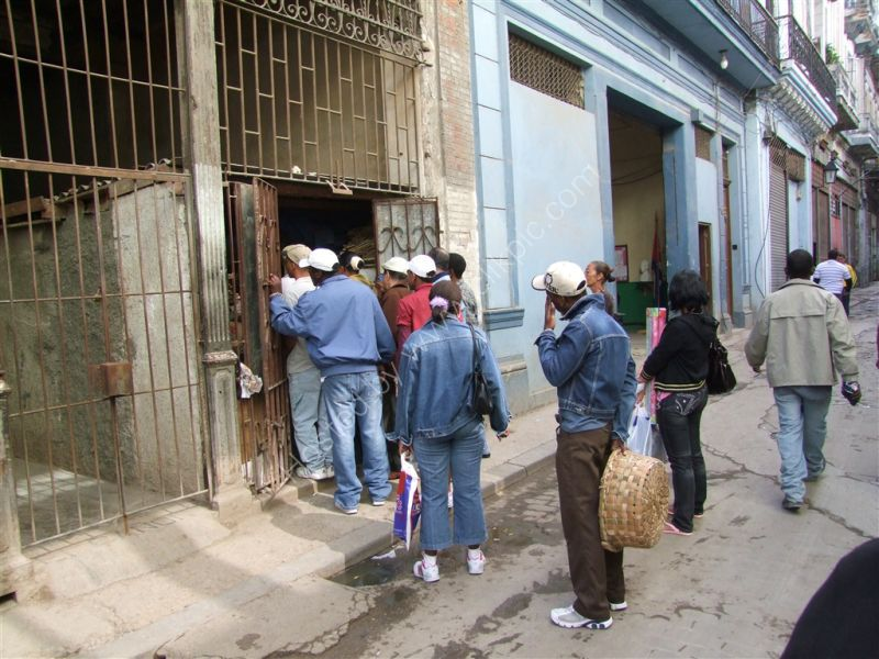 Cubans queing at a shop, Havana