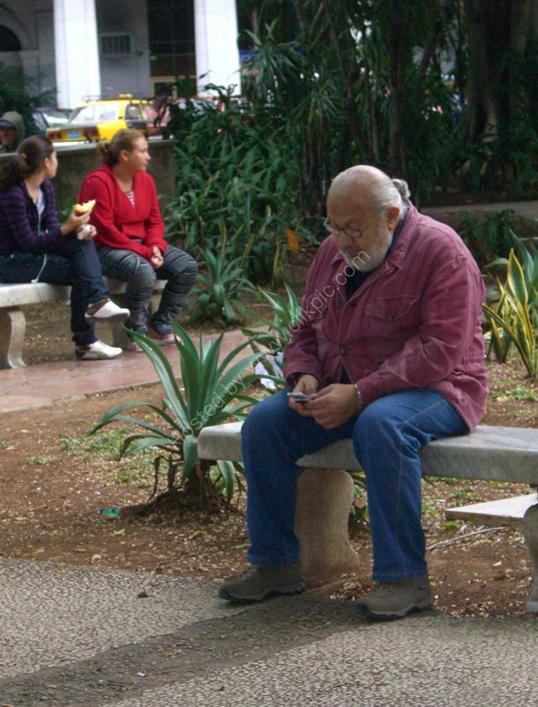 Texting, Central Park, Havana