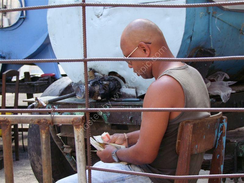 Water Seller counting his takings!, Havana