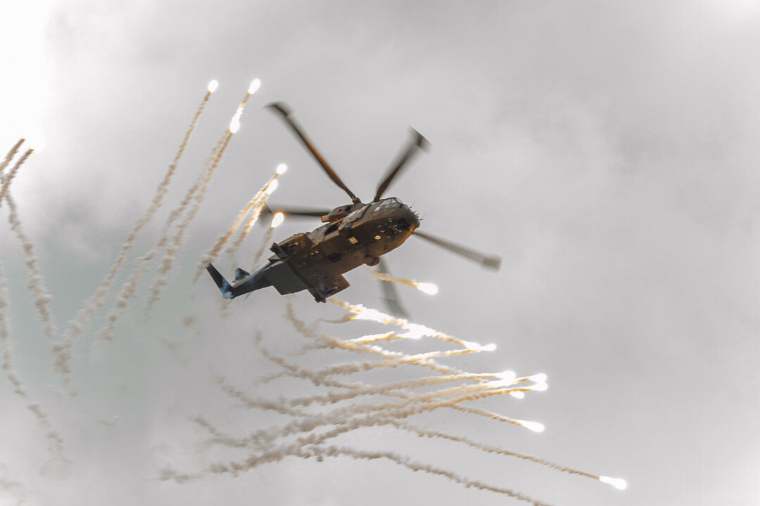 Royal Navy Merlin pops flares.