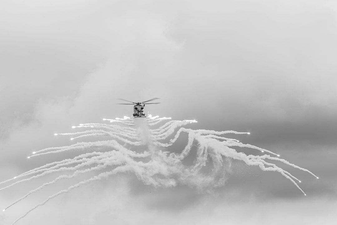 A Royal Navy Wildcat releases flares at RNAS Yeovilton.