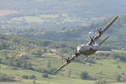 C130J Hercules enters the pass.