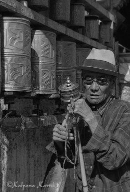 Turning prayer wheels in Lhasa Tibet