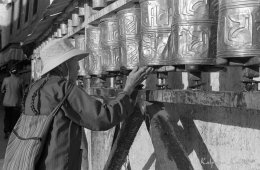 Turning prayers wheels in Tibet