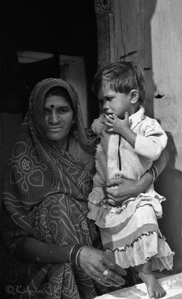 Mother and her son in front of their house Madya Pradesh India