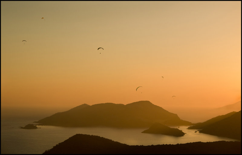 Paragliding at sunset.