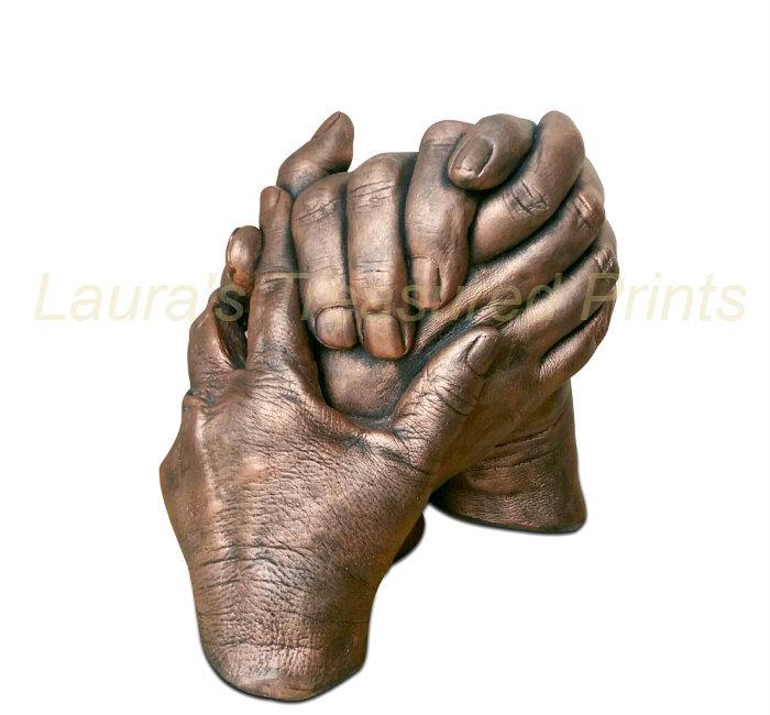 Bronze clasped hands