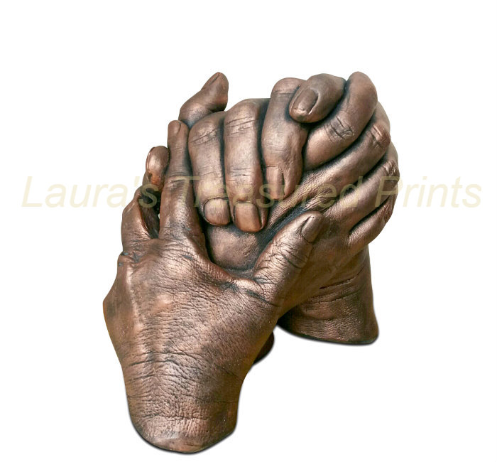 Bronze clasped hand cast