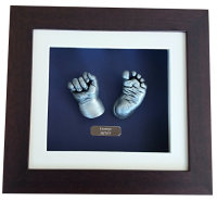 Deep blue background, framed hand & foot baby casts