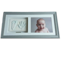2D hand & foot print framed with photo £160-165.