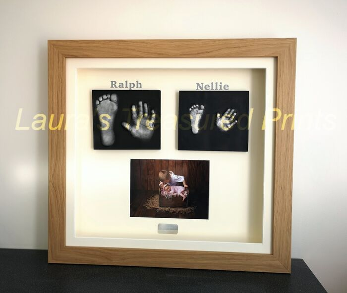 Two children's 2D casts with photo framed